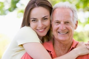 adult-woman-hugging-her-father_mdcnsw