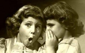 little-sisters-sharing-secret